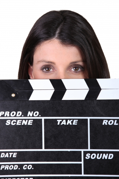 3521115-woman-holding-movie-clapper